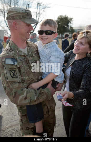 Staff Sgt. Jeff Valentine Greets His Son For The First Time In Nine Months  During