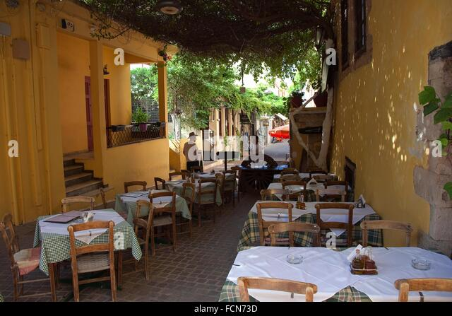 Man greek restaurant stock photos man greek restaurant for Apollon greek and european cuisine