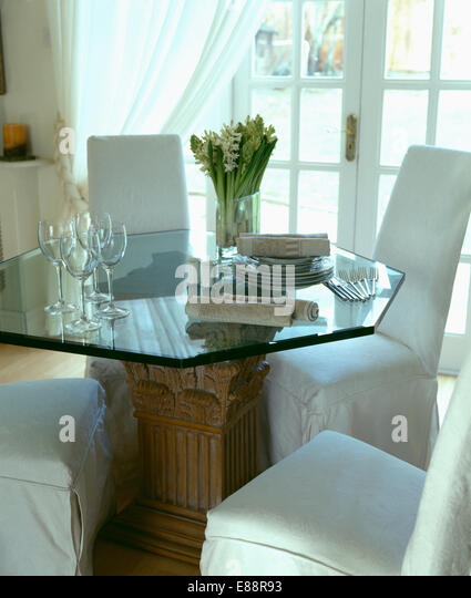 White Loose Covers On Chairs And Hexagonal Glass Table In Dining Room Converted From Garage