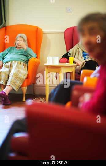 Elderly Women In A Dementia Unit Health And Social Care Nursing Home Sit