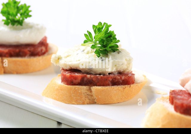 Salami canapes stock photos salami canapes stock images for Canape spreaders
