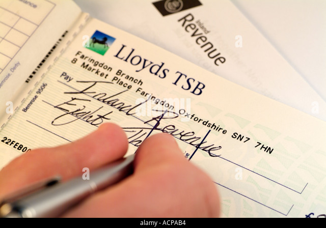 Cheque book close up stock photos cheque book close up stock writing a cheque to the united kingdom inland revenue to pay a tax bill close ccuart Images