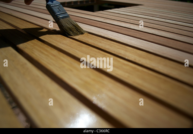 applying a wax protective varnish to wooden garden furniture stock image - Garden Furniture Varnish