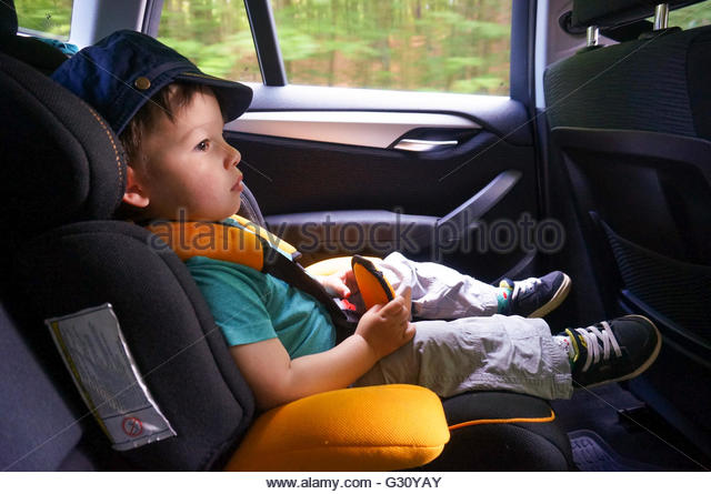 Old Child Car Seat Stock Photos & Old Child Car Seat Stock