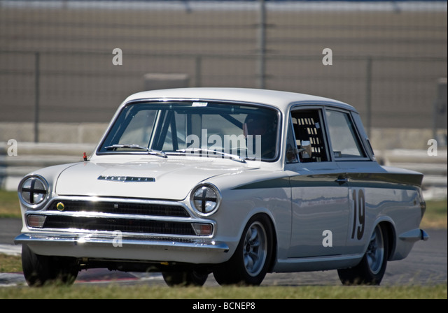 a 1966 ford lotus cortina at a vintage racing event stock image