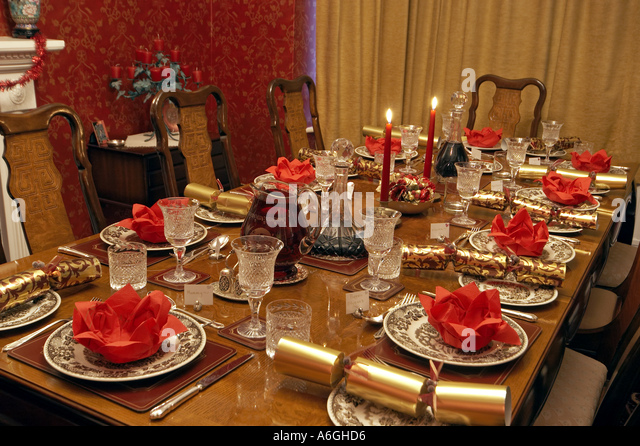 Table Set For Christmas Dinner table laid christmas dinner candles stock photos & table laid