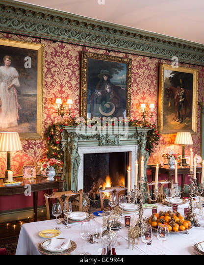 Gilt Framed Oil Paintings Above Fireplace In Dining Room Of Grade I Listed Victorian Gothic