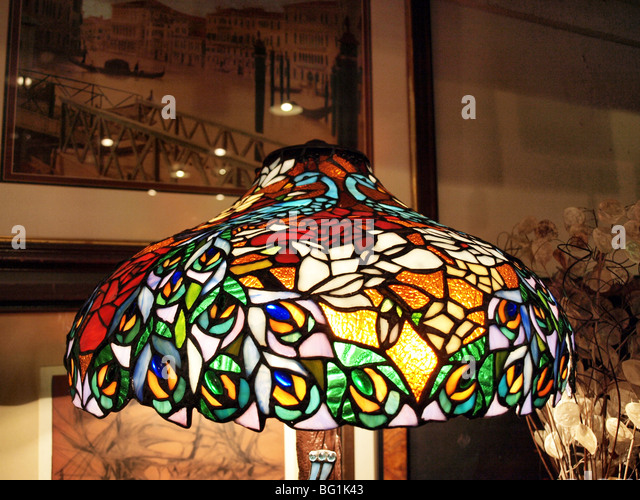 Hanging lamp shade stock photos hanging lamp shade stock images stained glass lamp shade with many colors and bright light below glass stock image mozeypictures Image collections