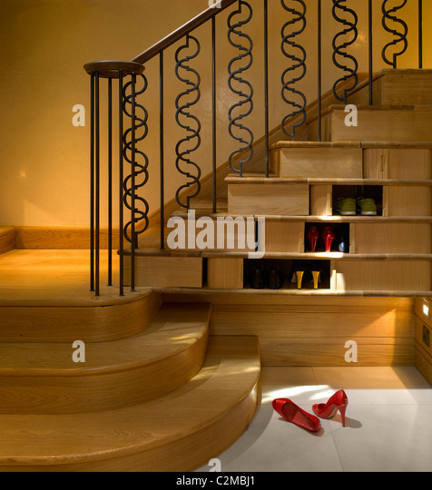 house in chelsea london with eleant understairs shoe shelves stock image