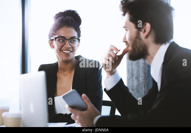Business people work together. Teamwork and partnership concept - Stock Image