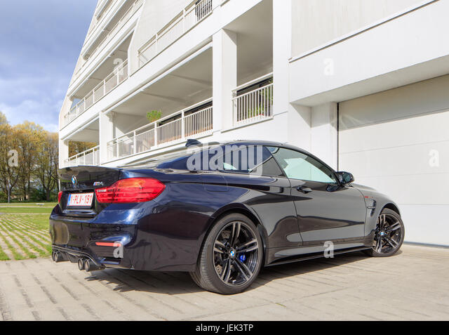 TURNHOUT-APRIL 22, 2017. BMW M4 in front of apartment building. The BMW M4 is a high-performance version of the - Stock Image