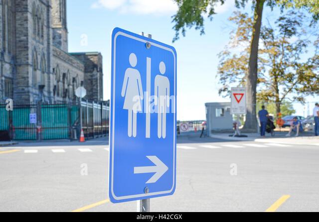 Bathroom Sign Next bathroom next to toilet stock photos & bathroom next to toilet