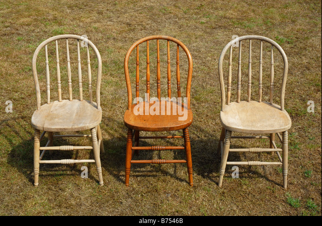 group of three bentwood chairs one polished and two unpolished standing on grass
