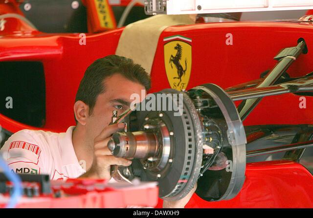 a-mechanic-of-the-scuderia-ferrari-team-
