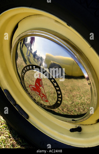reflection of car in hub cap off old gmh holden car vertical bapda8060 stock image