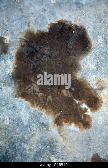 Oil dirt stock photos oil dirt stock images alamy for Removing dirt stains from concrete