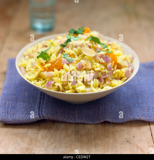 Chicken apricot and almond rice in a bowl topped with chopped ...