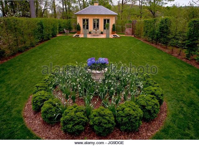 Garden With Cottage, Outdoor Furniture, Hydrangea, Bushes   Stock Image