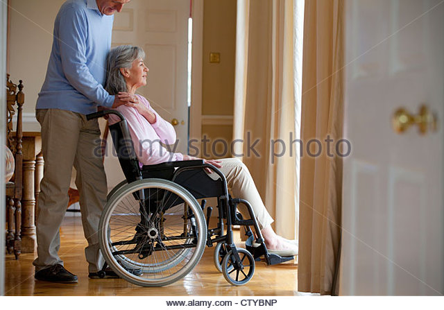 Senior man in wheelchair holding stock photos senior man for Basketball en chaise roulante