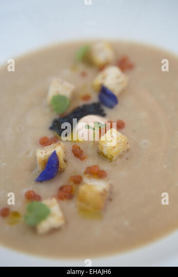 Caramelized cauliflower soup with smoked salmon mousse, Ossetra and ...