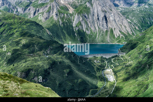 Lake of Morasco in a summer afternoon in the Formazza Valley with sunny light and shadow - Stock Image