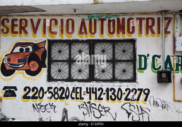 Street art shop sign stock photos street art shop sign for Colonial motors camden de