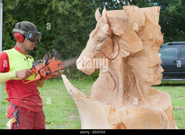 Chainsaw carving competition stock photos