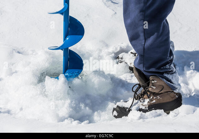Auger drilling stock photos auger drilling stock images for Ice fishing hole