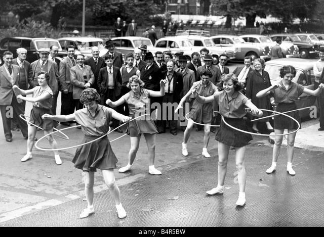 Girl swinging hula hoop