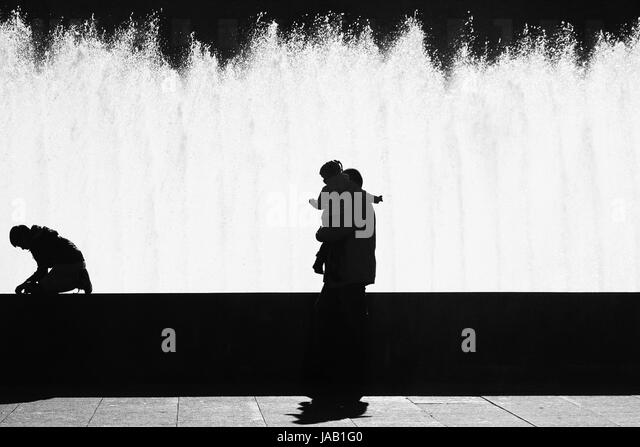 Black Silhouettes Of A Man With Child In His