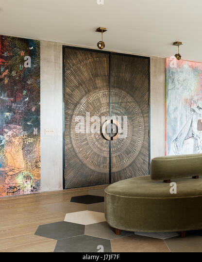 1950s beaten bronze double doors with large modern artwork in Istanbul apartment - Stock Image & Doors 1950\u0027s Stock Photos \u0026 Doors 1950\u0027s Stock Images - Alamy