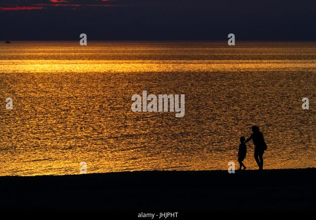 Taking Picture Sunset On Beach Stock Photos & Taking ...