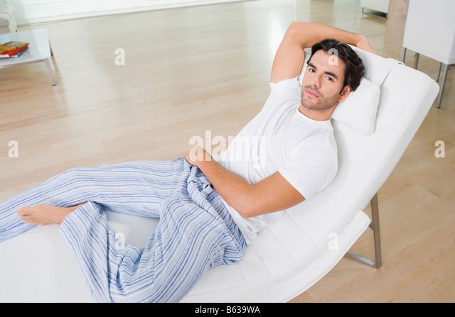 Portrait of a young man resting on a reclining chair - Stock Image  sc 1 st  Alamy & Reclining Chair Living Room Stock Photos u0026 Reclining Chair Living ... islam-shia.org