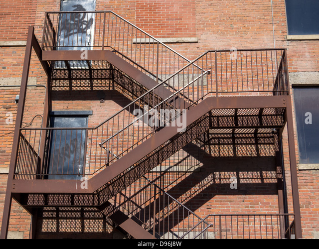 Attractive Fire Escape Stairs On The Side Of Old Brick Building   Stock Image