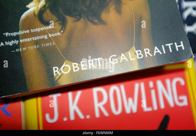 a robert galbraith book on top of a jk rowling book stock image