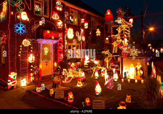 England Christmas decorations on outside of house and garden - Stock Image