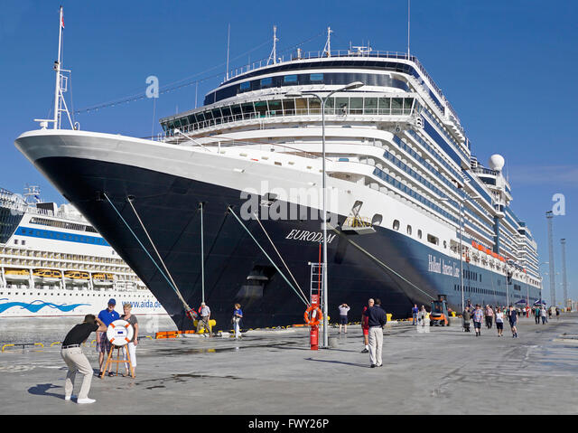 cruise ship passengers being photogrphed by ship photographer upon arrivel in port of tallinn estonia - Cruise Ship Photographer