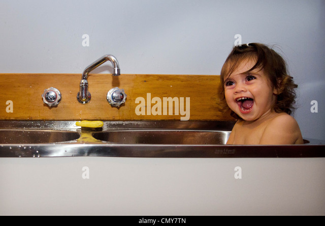 clean kitchen sink baby stock photos clean kitchen sink baby stock images alamy. Black Bedroom Furniture Sets. Home Design Ideas