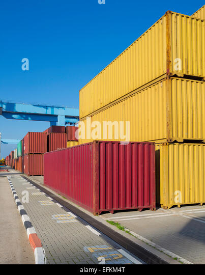 Cargo freight shipping containers at the docks  storage area in the sea  port - Stock