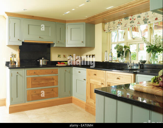 Fitted blind stock photos fitted blind stock images alamy for Country style kitchen blinds