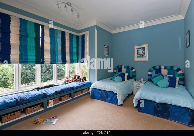 Spacious Boyu0027s Bedroom With Windowseat In Large Bay Window And Striped  Blinds   Stock Image