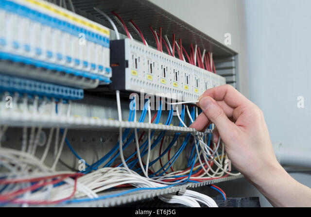 close up of electrician installing cable in distribution fusebox munich et6j5g fuse wire stock photos & fuse wire stock images alamy installing fuse box on boat at bayanpartner.co