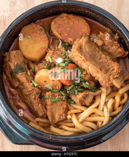 Gamjatang Korean Spicy Pork Rib Soup With Kimchi And Udon Stock Image