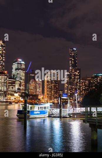 Brisbane city skyline with ferry stop after dark. Queensland. Australia. - Stock Image
