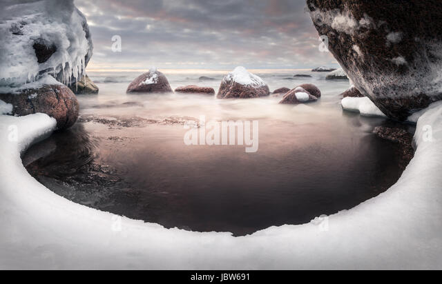 Scenic landscape with sea and lovely morning light at winter time - Stock Image