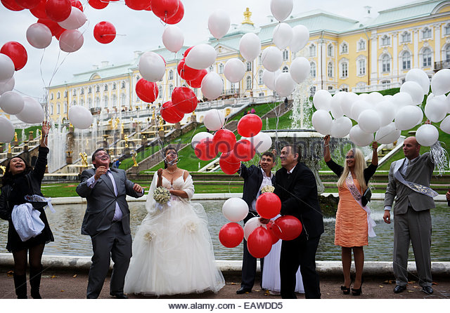 Wedding Party Releasing Balloons In The Gardens Of Peterhof Palace