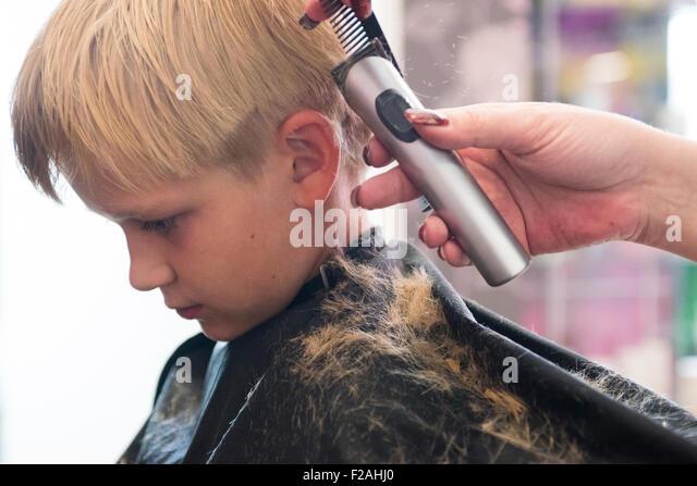Child Blond Boy Getting A Haircut
