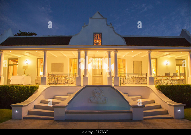 Luxury House With Porch Illuminated At Night Stock Image