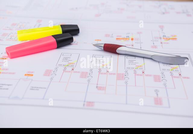 Circuit board blueprint stock photos circuit board blueprint pen and felt tip marker on electrical blueprint munich bavaria germany stock malvernweather Images
