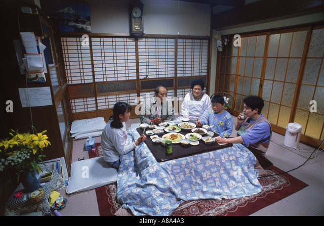 Japanese family dinner table stock photos japanese for Japanese eating table